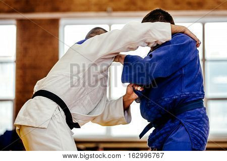 judoka man wrestlers heavyweight in judo competition stock photo