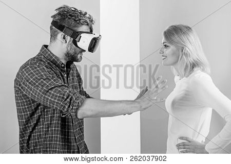 Man VR glasses going touch breasts virtual girl. Cyber relations instead real. Virtual reality pleasures. Virtual sex concept. Guy vr glasses interact in cyber space with girl. Flirt and relations stock photo