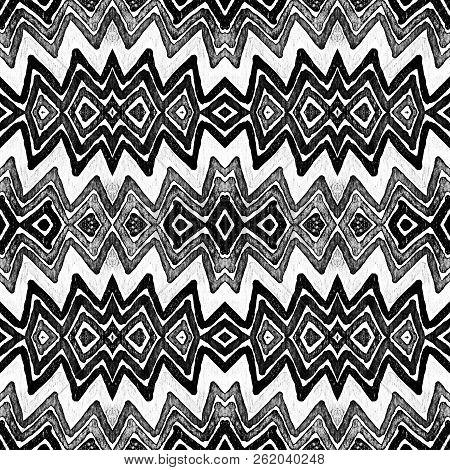 Dark black and white Geometric Watercolor. Decent Seamless Pattern. Hand Drawn Stripes. Brush Texture. Tempting Chevron Ornament. Fabric Cloth Swimwear Design Wallpaper Wrapping. stock photo