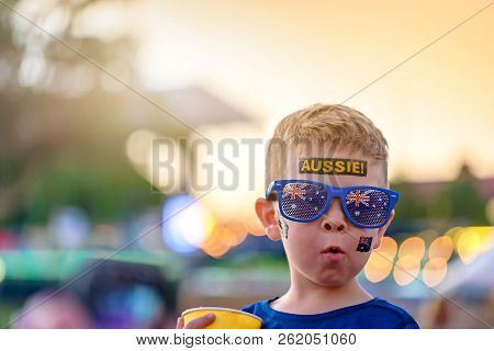 Cute Australian boy with flag tattoo on his face on Asutralia Day celebration in Adelaide stock photo