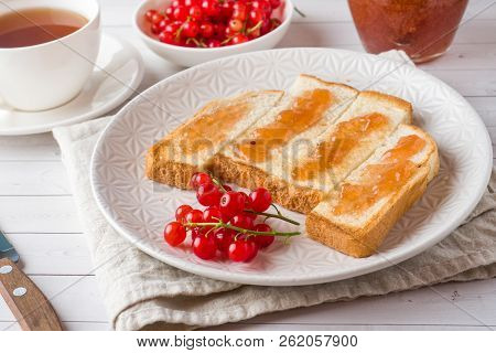 Healthy Breakfast with toast, jam and red currants, a Cup of cof stock photo