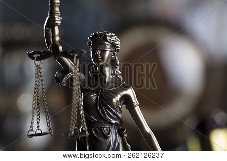 Law symbols in the old university library.  Themis - statue of justice. stock photo