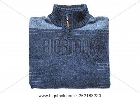 Folded blue knitted pullover on white background stock photo