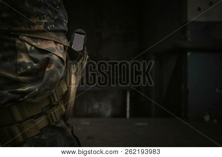 Weapon gun in the holster on the soldier leg. stock photo