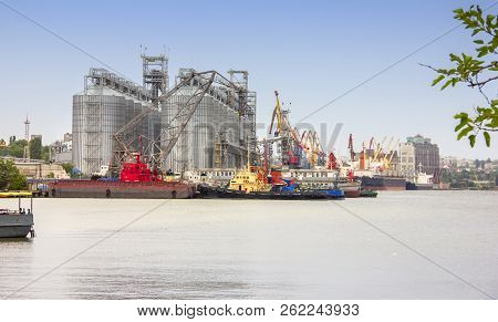 large grain terminal in the river port. Capacity and storage of grain. Transportation of agricultural products. stock photo