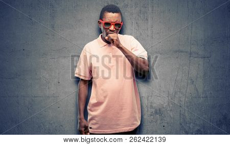 African black man wearing sunglasses sick and coughing, suffering asthma or bronchitis, medicine concept stock photo