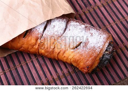 Poppy seed and walnut rolls, traditional Chistmas beigli cake on wooden table. stock photo