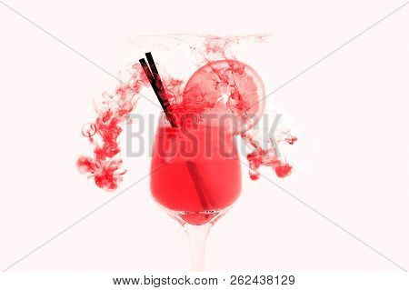 Cocktail in glass inside in water on a white background. Orange juice is under the water with bubbles. stock photo