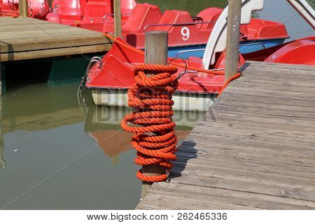 On the lake / Twine wrapped in a column stock photo