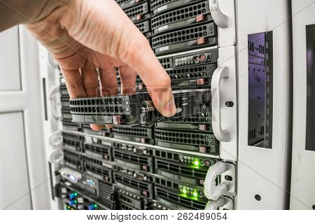 Several servers are located in the server room of the datacenter. Powerful Internet provider equipment. Front panel of central computers stock photo
