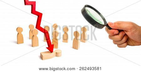 Magnifying glass is looking at the red arrow cleaves the person in front of a crowd. The concept of psychological pressure. Victim of the economic crisis, falling quotations and the collapse stock photo