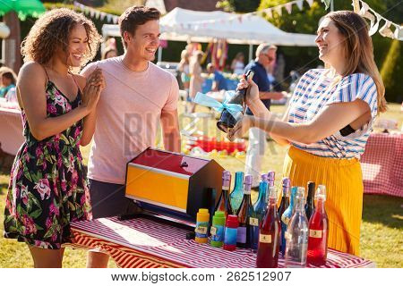 Couple Winning Prize At Tombola Stall At Busy Summer Garden Fete stock photo