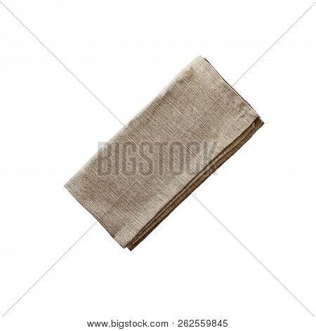 Folded linen napkin isolated over a white background with clipping path included. Image shot from overhead. stock photo