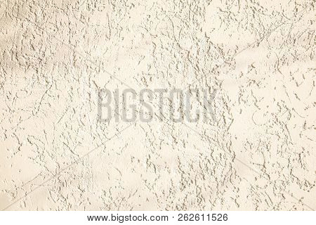 Beige facade plaster background. Single-layer monolithic gypsum decorative background. Monolayer glued wall from cement plaster. The appearance of the structure of the building. Silicate sand Cement plaster. Copy space stock photo