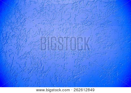 Blue facade plaster background. Single-layer monolithic gypsum decorative background. Monolayer glued wallpaper from cement plaster. The appearance of the structure of the building. Silicate sand Cement plaster. Copy space stock photo