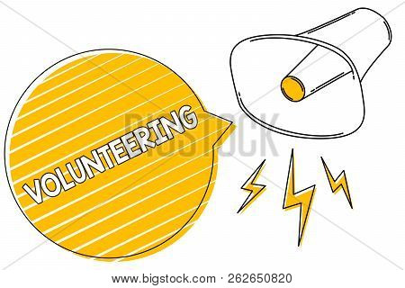 Handwriting text writing Volunteering. Concept meaning Provide services for no financial gain Willingly Oblige Megaphone loudspeaker yellow speech bubble stripes important loud message. stock photo