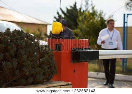 Security man checking car at the protective barrier and security stock photo