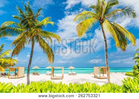 Relaxation and lounge scene with beach canopy and beach chairs, parasol on white sandy beach background. Luxury beach travel and tourism concept stock photo