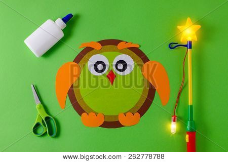 diy lantern for sankt martin day, traditional german feast, owl of color paper, glue, scissors, lanterns wand with light stock photo