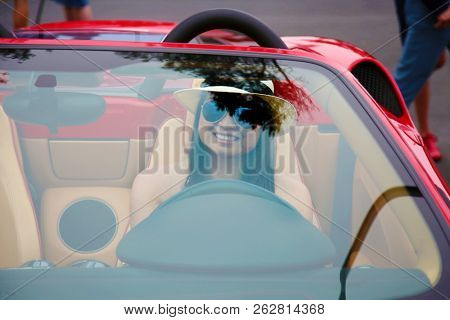 Beautiful girl in a Beautiful Car. Hot Sports Car with a Hot Model.  stock photo
