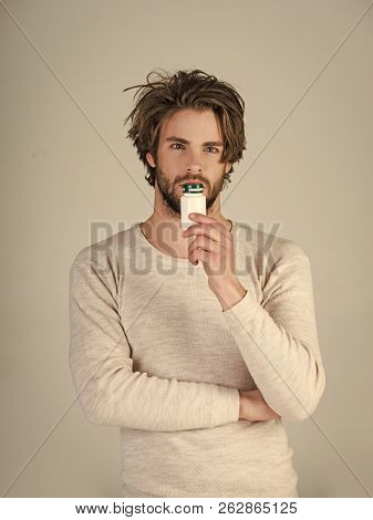 Cold, flu and headache treatment, hypnotic tablet. Drug and antidepressant, insomnia. Dieting pill and vitamin, man with anabolic. Man with pills in jar. Health and medicine, hangover. stock photo