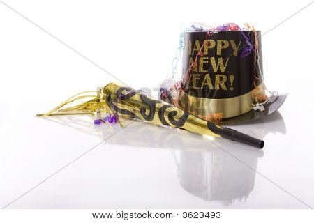 Party favors including top hat that says Happy New Year and horn isolated against white background stock photo