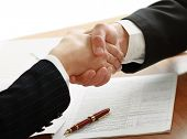 Handshake of business accomplices