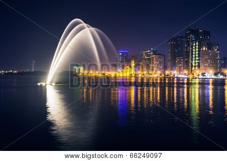 SHARJAH UAE - OCTOBER 29 2013: Musical fountain show. The Sharjah Fountain is one of the biggest fountains in the region. stock photo
