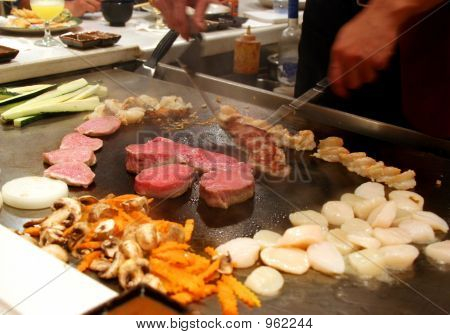 scenes from a tepanyaki style japanese cuisine performance in a restaurant. stock photo