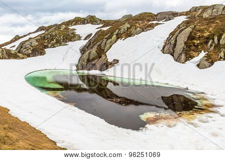Norway mountain Frozen Lake landscape. Lysevegen scenic road in winter FV 500: Sirdal to Kjerag, Norway, Europe. ** Note: Soft Focus at 100%, best at smaller sizes stock photo