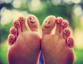 smiley faces on a couple of feet on each of the ten toes (VERY SHALLOW DOF - enormous toe on the pri