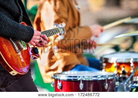 Festival music band. Hands playing on percussion instruments in city park . Drums with sticks closeu