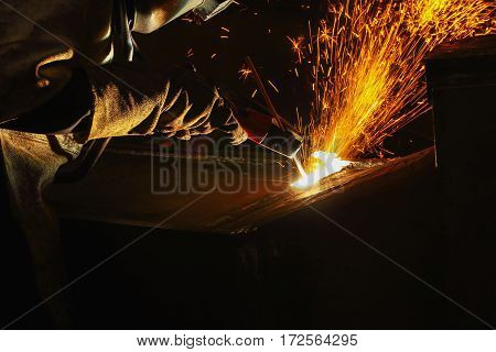 Welder arc Gouging carbon electrode rods with sparks and smoke stock photo