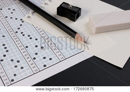School exam answer sheet and pen. Standard test form or answer sheet. Answer sheet focus on pencil. Bubble answer sheet with blank answer. stock photo