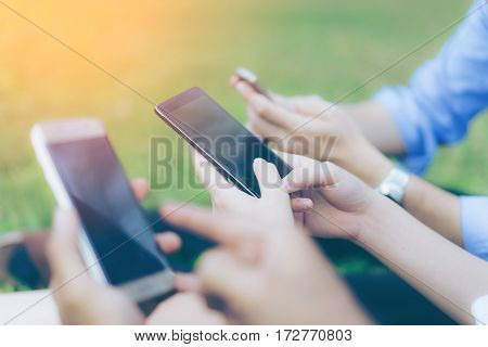 Hand of group business people using while reading smartphone. Portrait of Hand of group business people reading message with smart phone in outdoor.