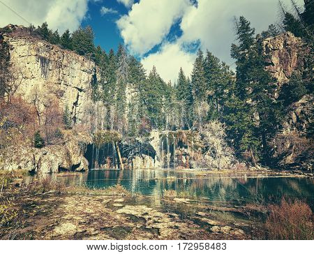 Retro toned picture of Hanging Lake in Glenwood Canyon Colorado USA. stock photo