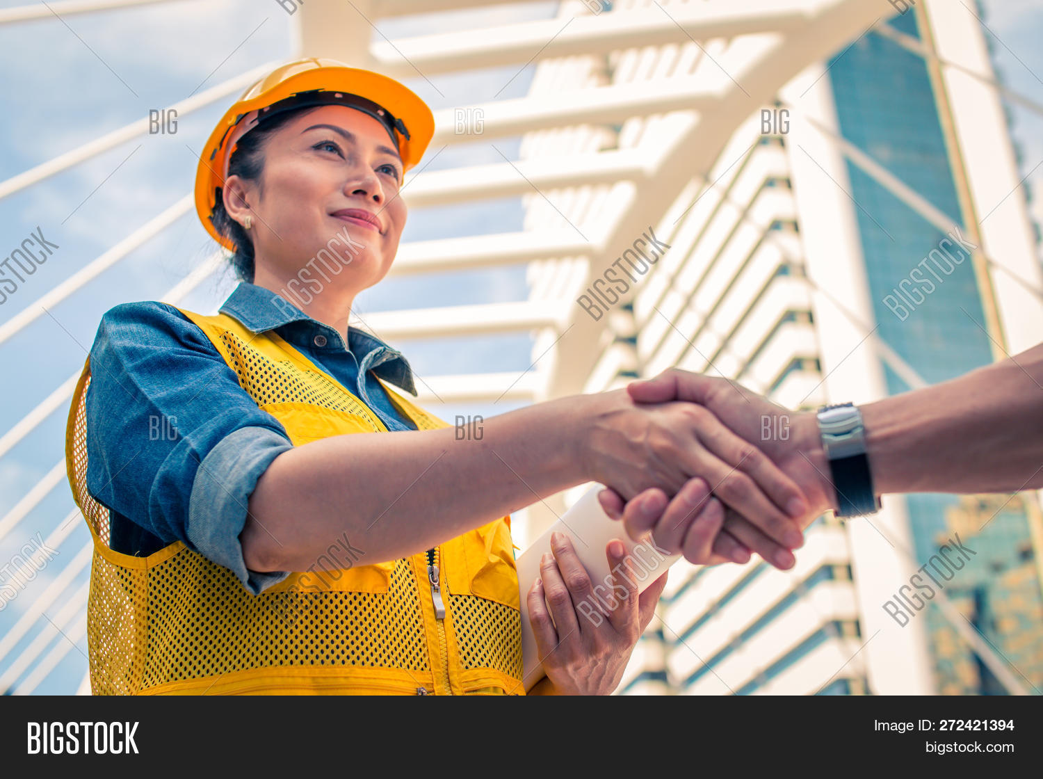 Construction And Engineer Concept. Construction Worker In Protective Uniform Shaking Hands Meeting F