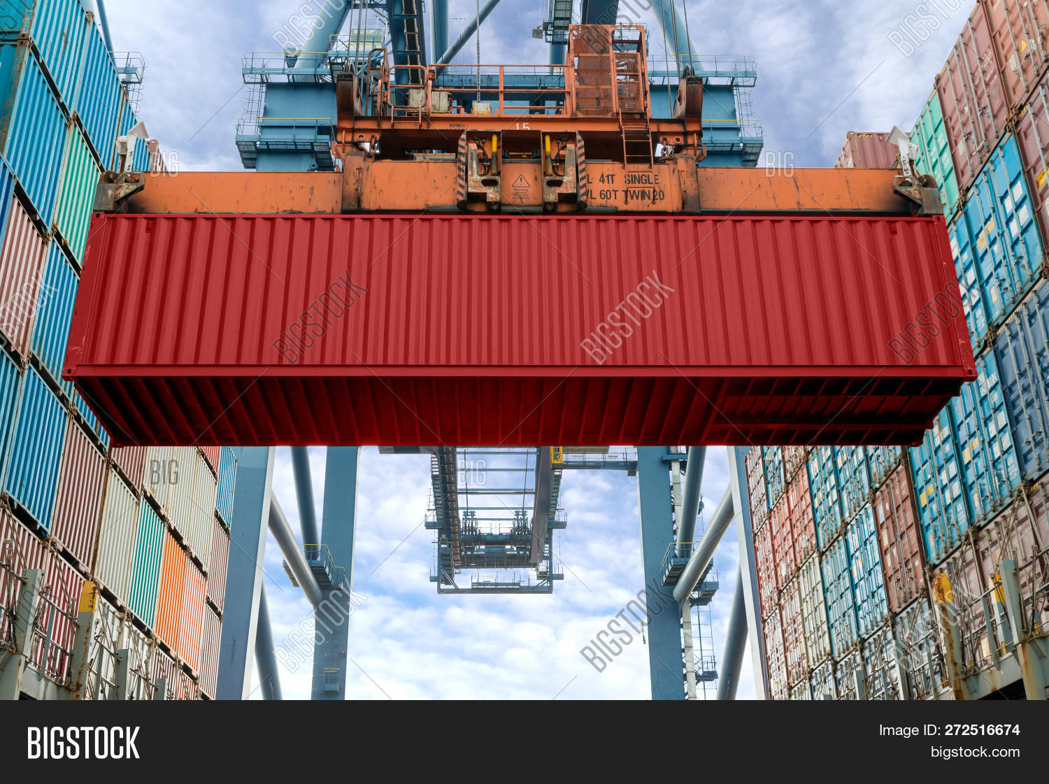 Industrial Crane Loading Containers In A Cargo Freight Ship. Container Ship In Import And Export Bus