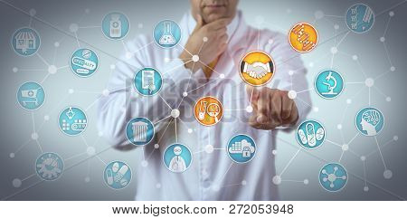 Pensive researcher reaching a deal between a pharmaceutical company and a pharmacogenomic technology partner. Healthcare and pharma concept for pharmacogenomics partnering, collaborative R & D. stock photo