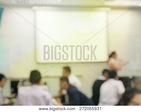 Blurred image of group of students are learning and sitting at desk using computer lap together in classroom for study and workshop in computers room at secondary school. education technology concept. stock photo
