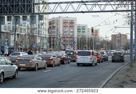Cars are at a traffic light with a red signal prohibits the street in Moscow stock photo