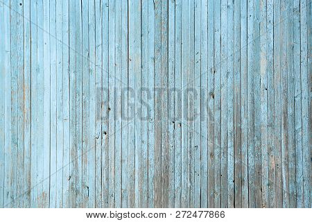 Wall of blue wooden slats. Exfoliated blue paint. Vertical laying, upright stock photo
