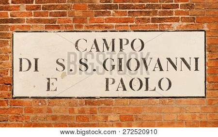 'Campo di SS Giavanni e Paolo ' (Saints John and Paul Square) old traditional road sign on a brick wall in Venice stock photo