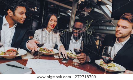 Business People Colleagues Corporate in Restaurant. Group Business People Geting Order in Restaurant. Corporate, Collaboration Concept. Team Professional Worker. Teamwork. Celebration Together. stock photo