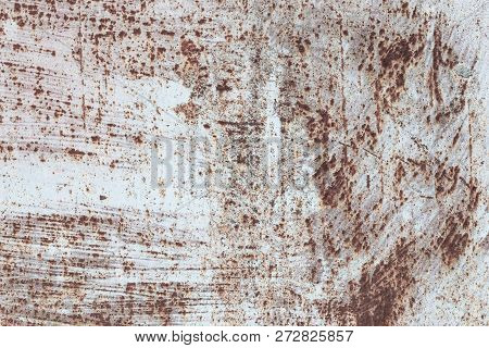 texture of rusty iron, cracked paint on an old metallic surface, sheet of rusty metal with cracked and flaky paint, abstract rusty metal texture. stock photo