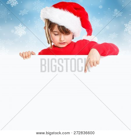 Christmas Santa Claus child kid girl pointing looking empty banner square copyspace copy space stock photo