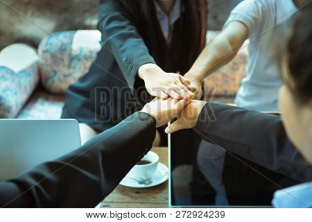 Business trust commitment which Business Partners holding hands with Help, trust ,support ,empathy and factors relationship marketing for reach successful achievement and meeting commit concept. stock photo