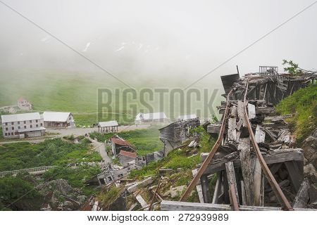 Ruins of an old abandoned mining ore track at Independence Mine along Alaska's Hatcher Pass stock photo