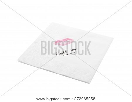 Paper napkin with lipstick mark and words CALL ME on white background stock photo