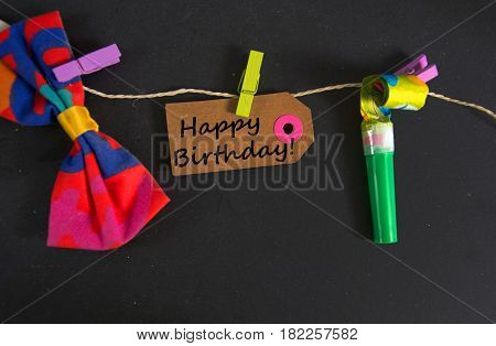 Happy Birthday written on a paper tag stock photo